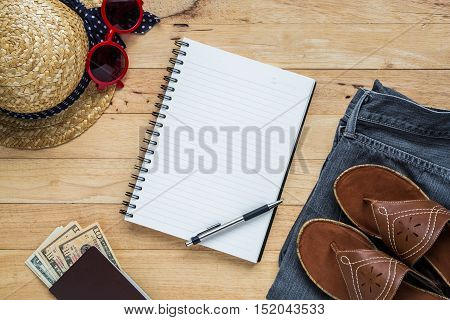 Flat lay travel accessories costumes notebook and copy space. PassportsThe cost jean sunglasses hat. Top view.
