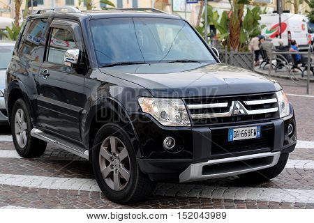 San Remo Italy - October 16 2016: Black Mitsubishi Pajero SUV Badly Parked in the Street of San Remo Italia