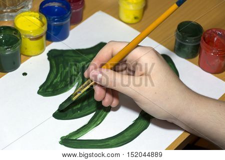 draw a tree a fir with brush and green paint on a white sheet of paper gouache creativity drawing hand