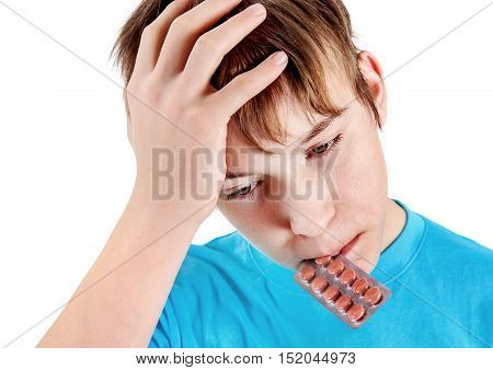 Sad Kid with the Pills Isolated on the White Background