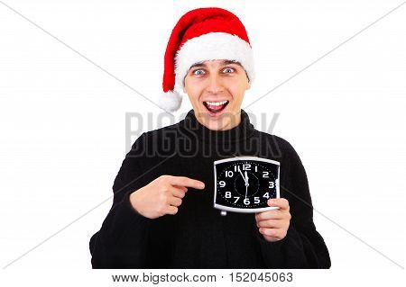 Happy Young Man in Santa Hat with the Clock On The White Background