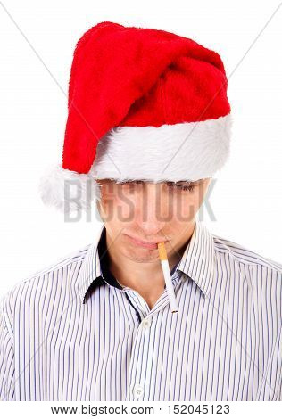 Sad Young Man in Santa Hat with Cigarette Isolated on the White Background