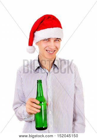 Cheerful Young Man in Santa Hat with a Bottle of the Beer on the White Background