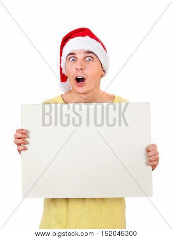 Surprised Young Man in Santa's Hat with Blank Board Isolated On The White Background