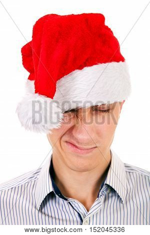 Displeased Young Man in Santa Hat on the White Background