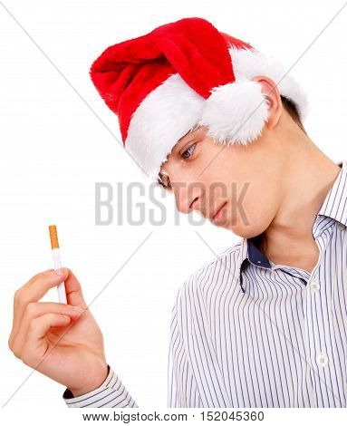 Pensive Young Man in Santa Hat with Cigarette Isolated on the White Background