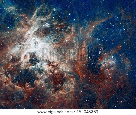 Star-Forming Region in the super star cluster called R136. The Tarantula Nebula or 30 Doradus is an H II region in the Large Magellanic Cloud. Elements of this image furnished by NASA.