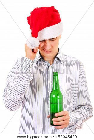 Tired Young Man in Santa Hat with a Bottle of the Beer on the White Background