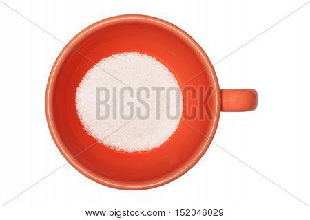 Orange cup with sugar on white background