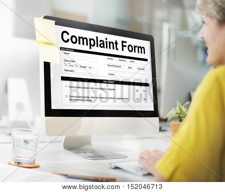 Lady Filling Up Complaint Form