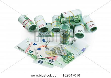 Euro banknotes in stacks and rolls isolate on white