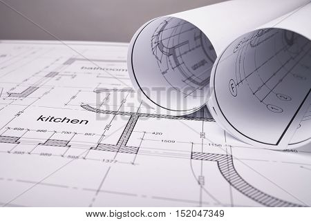 Construction of the building layout, building drawing on paper, drawings rolled in a roll