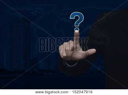 Businessman pressing question mark sign icon over world map and city tower background Customer support concept Elements of this image furnished by NASA