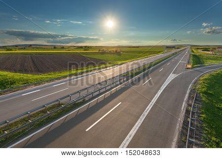 Empty straight highway towards the sun at beautiful sunny day near Belgeade Serbia.