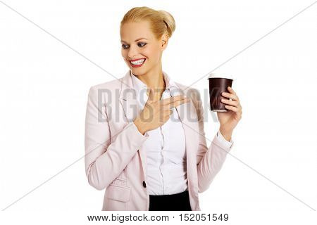 Smile business woman pointing for paper cup