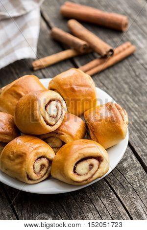 Mini cinnamon buns on plate.
