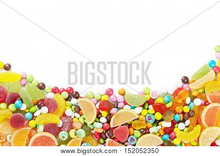 Colorful candies, jelly and marmalade. Isolated on white background with copy space