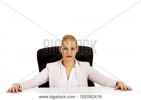 Happy business woman sitting behind the desk