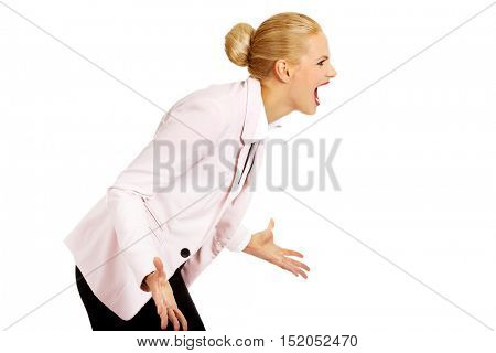 Angry and furious business woman screaming for someone