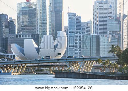 Singapore, Republic of Singapore - May 4, 2016: evening traffic at Sheares Ave crossing Marina Bay
