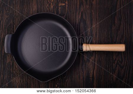 iron frying pans rustic wood background.