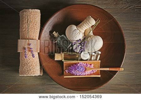 Beautiful spa composition with lavender on wooden table
