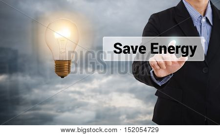 Businessman press the button save energy light bulb concept ecology