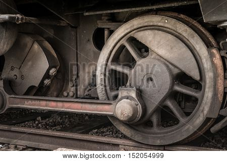 Closeup of the drive wheel from an old steam locomotive.