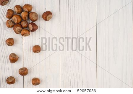 Hazelnuts on a old wooden table. Abstract background empty template. Top view