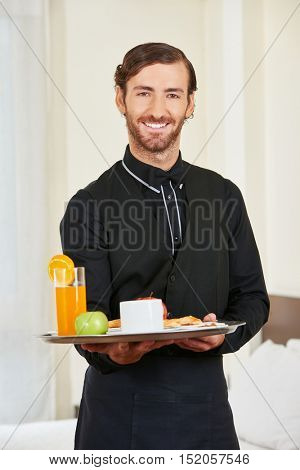 Page serving healthy breakfast in hotel room as room service
