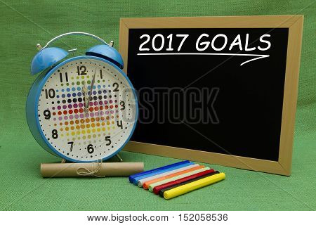 2017 New Year objectives written on a small blackboard.
