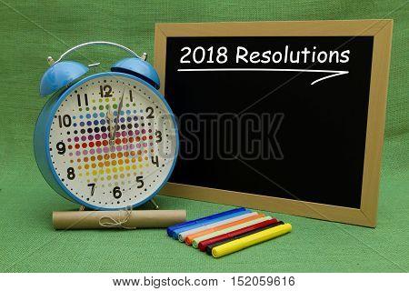 2018 New Year resolutions written on a small blackboard.