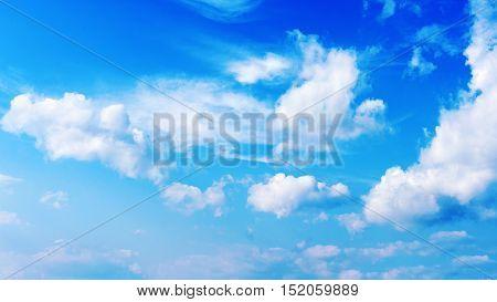 Blue sky and beautiful white clouds. Closeup.