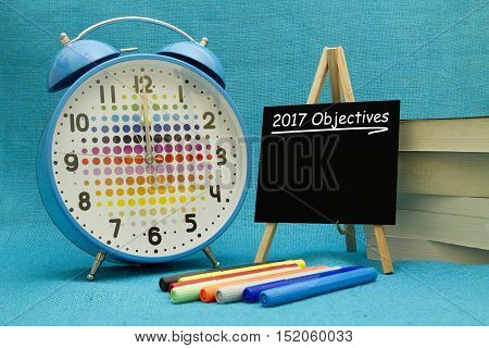 2017 New Year objectives written on a small blackboard.