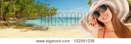 Beautiful young woman portrait, looking at tropical beach and smiling. Travel and relaxation concept
