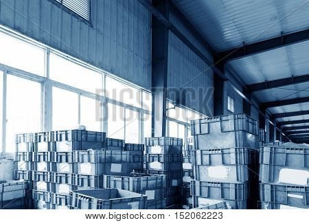 Warehouse plastic containers used to display small items.