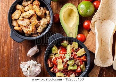 Ingredients Ready For Preparing Chicken Tacos With Salsa Made Fr