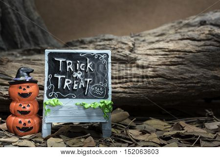 Three stack pumpkin head jack with trick or treat board in halloween night