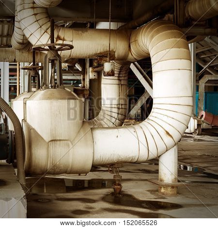 Equipment cables and piping as found inside of industrial power plant
