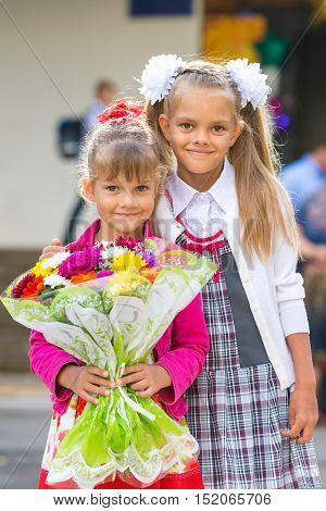 Portrait Of Two Girls In School September 1 - The First-grader And Her Younger Sister With A Bouquet