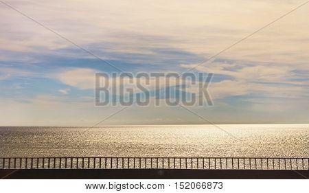 Comfort beauty road along sunny happy sea under sky