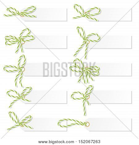 Set of tag labels with green rope bakers twine bows on white background