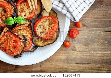 Tasty vegetarian pizza topping, delicious baked eggplant with tomato and cheese, traditional italian food, healthy organic nutrition, Thanksgiving homemade food