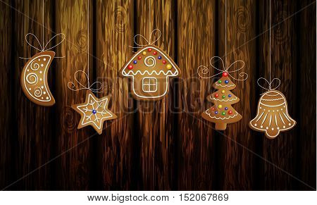 Gingerbread man tree bell half moon and stars with decorations Cristmas background on wood