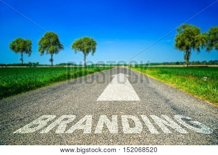 Branding Word Painted On Asphalt Road