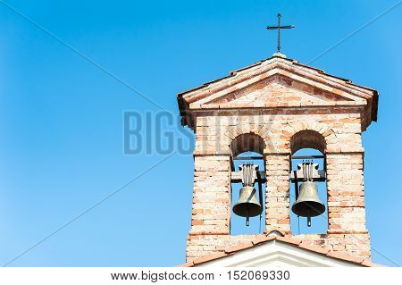 Small bell tower with a bell of a country church in the 14th century