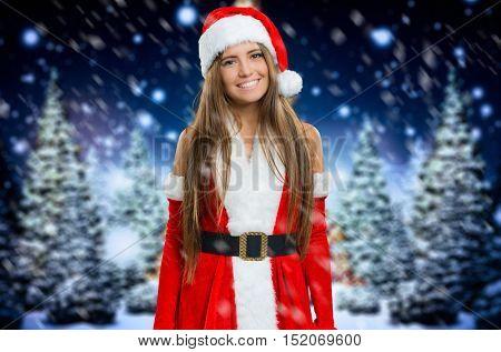 Beautiful cute Santa Claus woman portrait under the snow