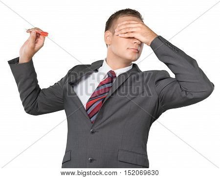 Portrait of a Businessman Throwing Dart with Hand over Eyes