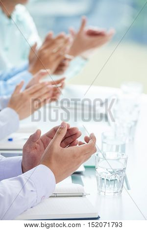 Hands of business people clapping at presentation