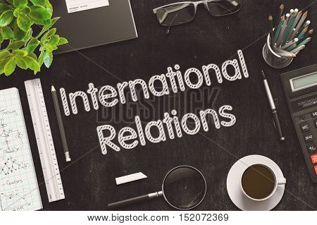 International Relations on Black Chalkboard. 3d Rendering. Toned Illustration.